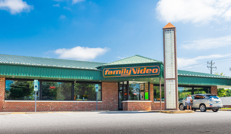 HICKORY, NC, USA-9218: A Family Video store, one in the only chain of video stores in the U.S., with one car and one female in parking lot.