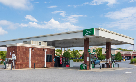 HICKORY, NC, USA-9/2/18:  A Lowe's Food store which sells gas. One white male visible in distant right, not essential to image.