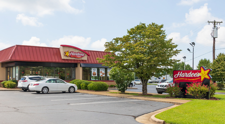 NEWTON, NC, USA-9218: A Hardees fast food restaurant, one of over 3800 in the chain. Parking lot with 6 cars, and no people. Editorial