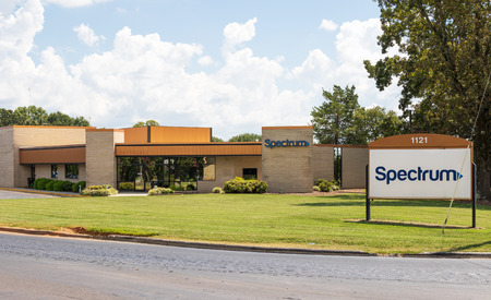 HICKORY, NC, USA-9618:  Front lawn, building and road sign of a local Spectrum building, formerrly Charter, cable, internet and telephone provider. Editorial