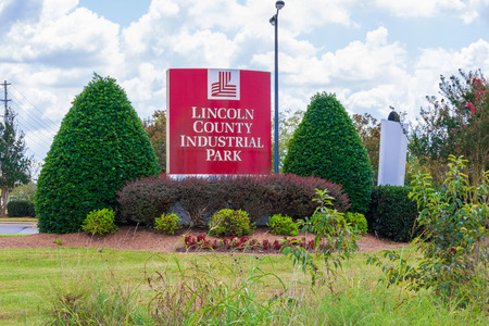 LINCOLNTON, NC, USA-9218:  Sign and logo framed by shrubbery  for the Lincoln County Industrial Park.