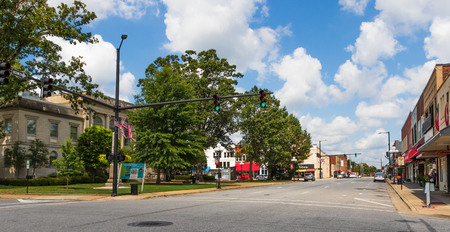 NEWTON, NC, USA- A view of a main street in the small southern town of Newton, NC, seat of Catawba county. The old courthouse is in the left foreground. One woman window shops in right foreground.