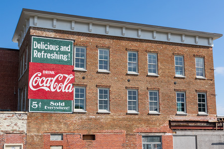 JOHNSON CITY, TN, USA-93018: A refreshed version of an old Coca-cola sign is displayed on the side of an old brick building in downtown. Editorial
