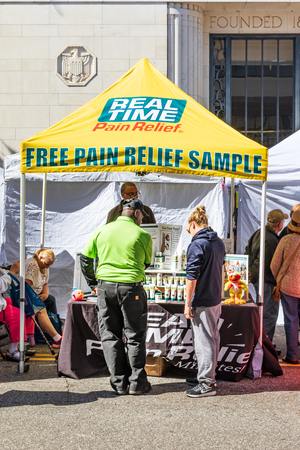 HICKORY, NC, USA-101418: A booth at an autumn festival attracts interest with its offer of Real Time pain relief.