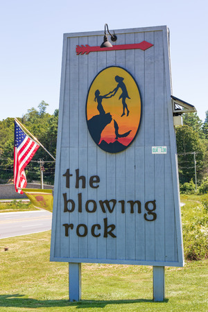 BLOWING ROCK, NC, USA,-23 AUG 2018: A sign advertising the blowing rock attraction, for which the town is named. Editorial