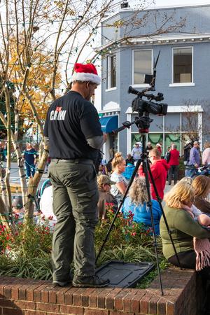 LINCOLNTON, NC, USA-11/25/18: A videographer prepares to film the Christmas parade.