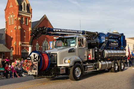 LINCOLNTON, NC, USA-11/25/18:  The city's Vacuum truck, used for sewage collection,  is driven in the local Christmas parade.