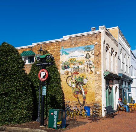 DAVIDSON, NC, USA-12419: Farmers Market advertisement on wall of downtown building. Editorial
