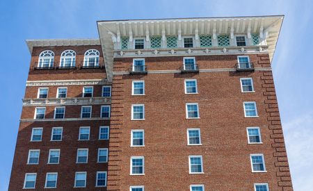 ASHEVILLE, NC, USA-2319: The top cornice and overhang of the Battery Park Hotel building, now used for senior housing.