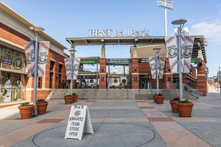 CHARLOTTE, NC, USA-1819: South entrance to the BB&T Ballpark in Christmas season, home of the Charlotte Knights.  Christmas wreaths on gates.