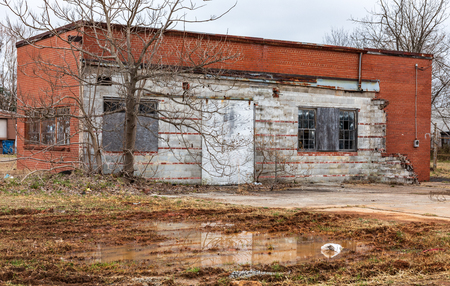 HICKORY, NC, USA-21719: A small brick garage or industrial building sets abandoned, and deteriorating.
