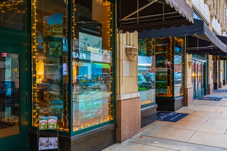 ASHEVILLE, NC, USA-21619: Strings of lights and reflections fom the street shine in realtors storefront windows along Page St. Editorial