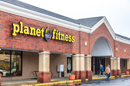 HICKORY, NC, USA-22219: A Planet Fitness gym, with people entering and exiting.