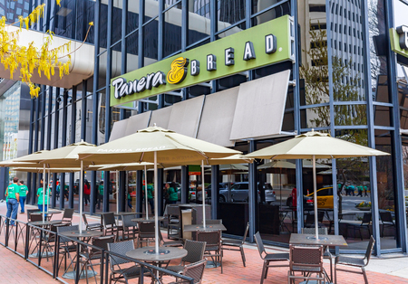 CHARLOTTE, NC, USA-31619: A Panera Bread restaurant in uptown Charlotte, with sidewalk seating.