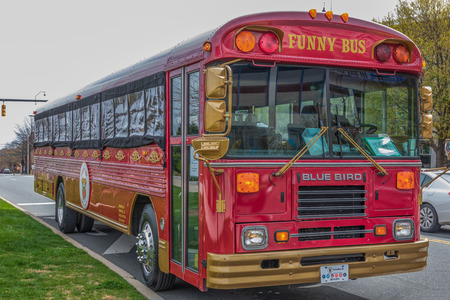 CHARLOTTE, NC, USA-31619: A city tour bus, combined with an onboard comedy show, stands idle at First Ward Park.