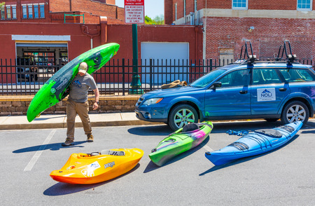 JOHNSON CITY, TN, USA-42719: A selection of kayaks on display at a Saturday farmers market in Johnson City.