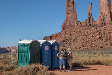 MONUMENT VALLEY, near KAYENTA, AZ, USA-10215:  Three women stand talking while waiting for access to portable toilets in Monument Valley.