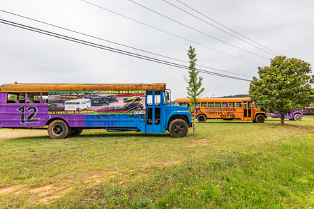 NEWTON, NC, USA--52219: Old school buses stripped and painted for use as racing crashing event.