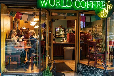 ASHEVILLE, NC, USA-16 FEB  2019: Storefront windows of the World Coffee Cafe and coffee shop on Battery Park Ave. Editorial