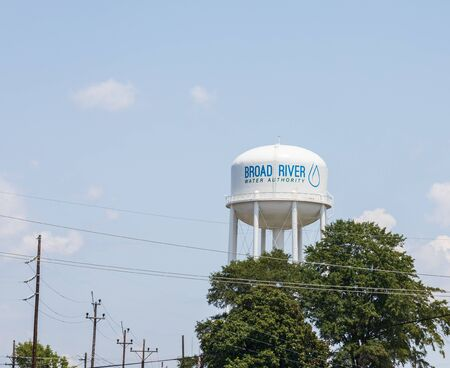 SPINDALE, NC, USA-27 jULY  19: Water tank for Broad River Water Authority stands over the  town of Spindale, NC.