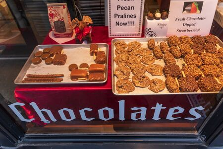 ASHEVILLE, NC, USA-16 FEB  2019: A specialty chocolate store in Asheville, displaying goods in a store window, with window marked