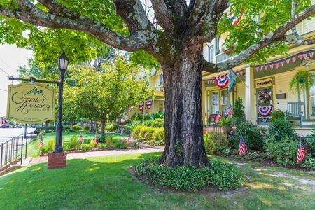 RUTHERFORD, NC, USA-27 JULY 19: Carrier Houses Bed & Breakfast, with a ancient oak tree, stand on Main Street.