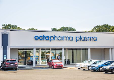 Charlotte, NC, USA-28 July 2019: A man stands outside the  the Octapharma Plasma Center on South Blvd.