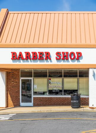 CHARLOTTE, NC, USA-28 July 2019: The Brewington Barber & Styling Shop is in a small shopping center on South Blvd. Editorial