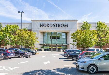 CHARLOTTE, NC, USA-28 July 2019: Entrance to Nordstrom Department store, with crowded parking lot on a sunny summer day.