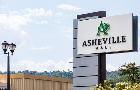 ASHEVILLE, NC,, USA-27 JULY 2019: The main entrance to parking lot of Asheville Mall, showing the  street sign.