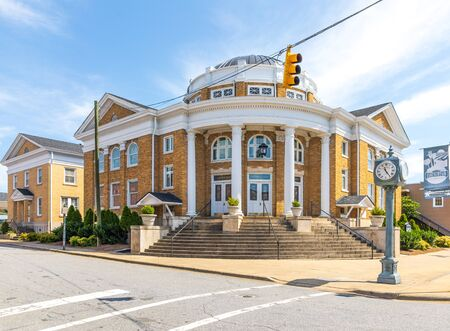 LINCOLNTON, NC, USA-9 AUGUST 2019: The stately First Methodist Church with rotunda, built in 1920, in downtown Lincolnton.