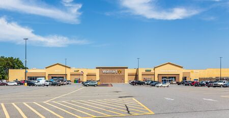 CHERRYVILLE, NC, USA-9 AUGUST 2019: A Walmart Superstore and the parking lot with cars.