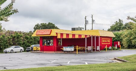 LONGVIEW, NC, USA-8 AUGUST, 2019:  A bright red-painted fast food drive-in restaurant, called