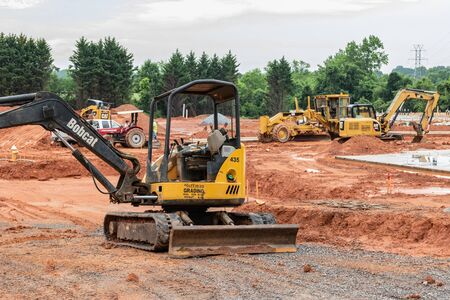 HICKORY, NC, USA-21 MAY 2019: Earth--moving machinery prepares building site for apartment complex.