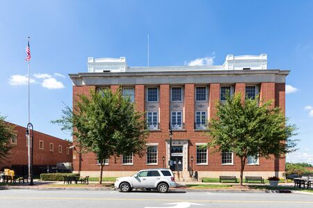 STATESVILLE, NC, USA-1 SEPTEMBER 2019: Front exterior view of the building marked as Statesville Post Office and Courthouse, now serving as Federal office building.