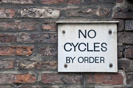 'cycles:  No Cycles  sign on brick wall