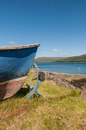 keel: Keel of old fishing boat and anchor at Lochcarron