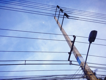 wire: Blue sky and electric post