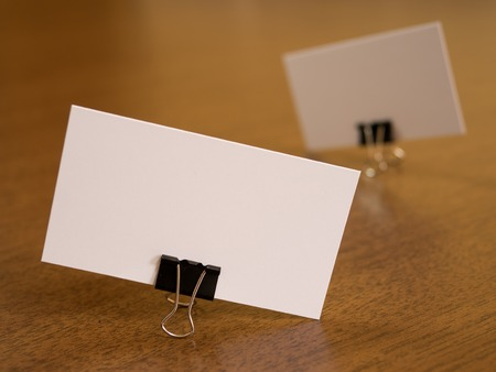 fastener: Business cards with paperclip fastener on a desk Stock Photo