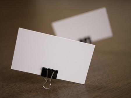 fastener: Business cards with clip fastener on a desk. Defocus composition.
