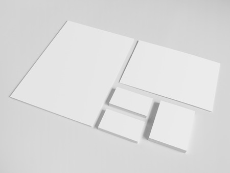 business cards: Blank business cards with a pile of papers and envelopes. Mockup on white background. Stock Photo