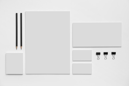 stationery: Blank branding mockup with gray business cards, envelopes and notepads isolated on white background. Stock Photo