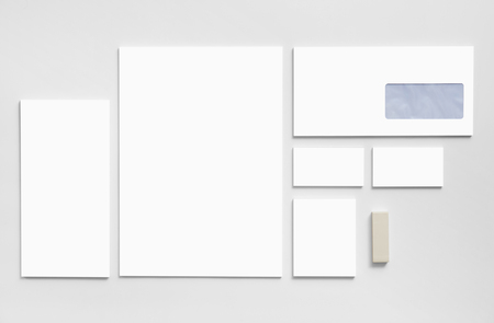 envelope design: Branding mockup template with white business cards, envelopes and notepads isolated on gray background.