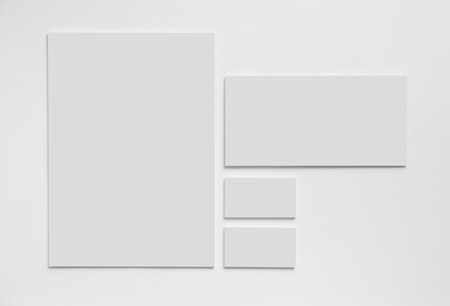 Gray simple stationery mock-up template on white background. Envelope, business cards and A4 paper. 写真素材