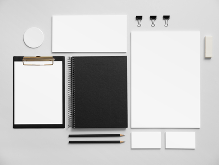 Branding mockup. Set of office stationery for brand presentation. Black notepad, blank business cards ant letterhead