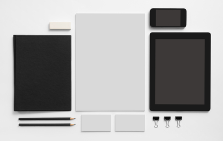 branding: Branding mockup. Set of stationery with tablet and mobile phone. Black notepad, blank business cards ant letterhead. Stock Photo