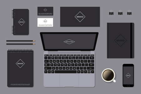 identity: Dark corporate identity mock-up template on gray background. Editable vector format. Set of elements with laptop, notepads and business cards. Illustration