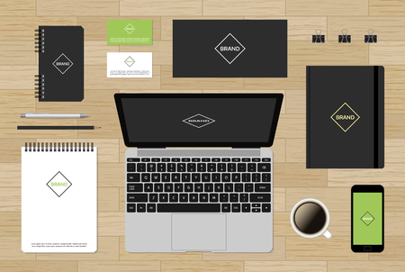 replacing: Branding template mockup for corporate identity presentation on wooden background. Ready for replacing your brand. Mobile phone with envelopes and business cards. Gray laptop.