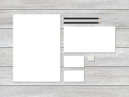 papeleria: Modelo del papel del negocio maqueta en el fondo de madera.