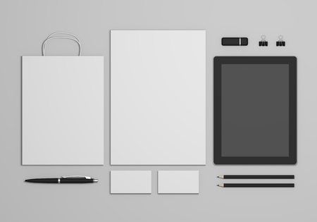 Mockup business branding template on gray background. Set of stationery with a black tablet and a shopping bag. 3d illustration.